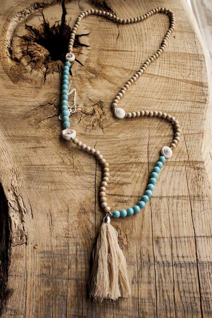 boho ibiza mala ketting lichtblauw hout met kwastje