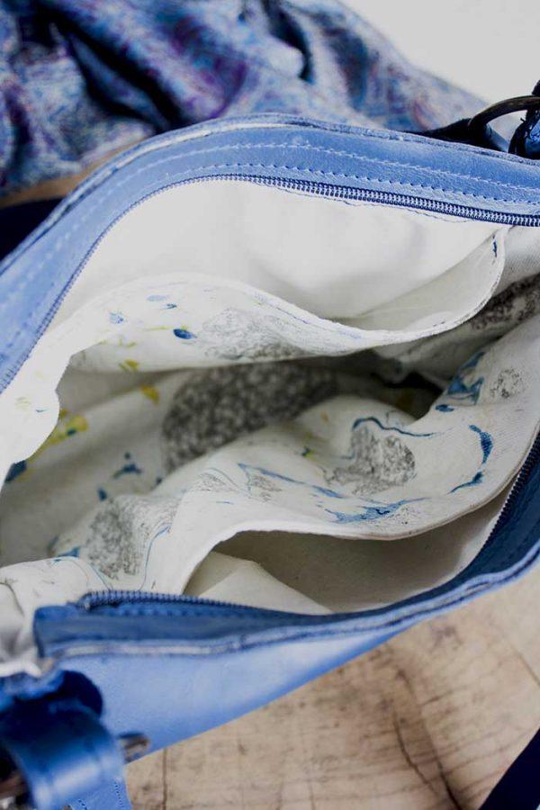 blauwe schoudertas zacht glad echt leer
